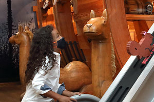 young girl playing in noahs ark