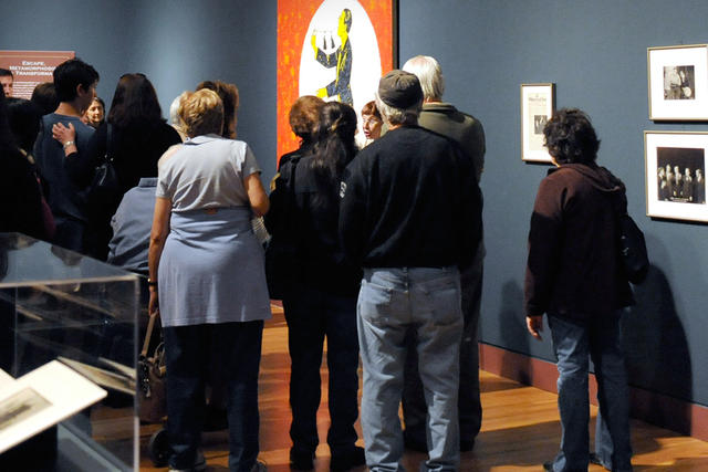 People on a tour in an exhibitiion gallery