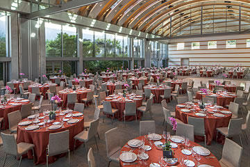 Round tables with chairs and place settings inside Guerin Pavilion