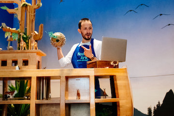 man telling a story with puppet
