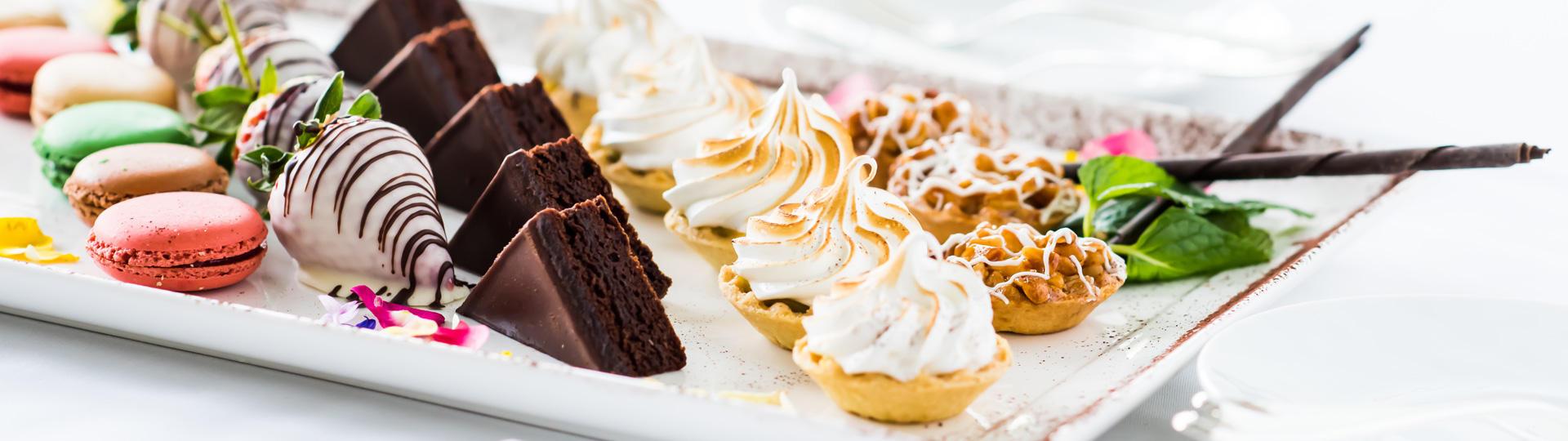 Various desserts arranges on a platter