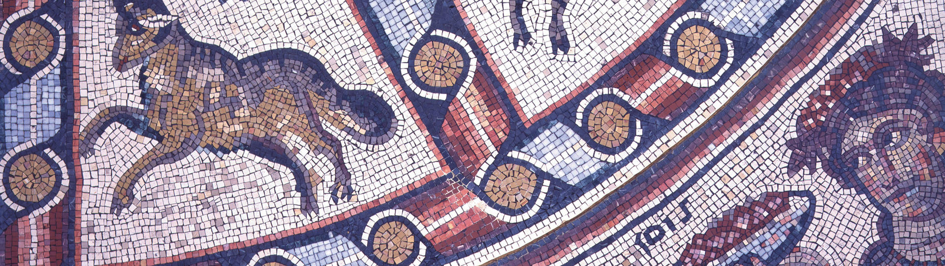 Mosaic floor replica showing bull and man holding a plate