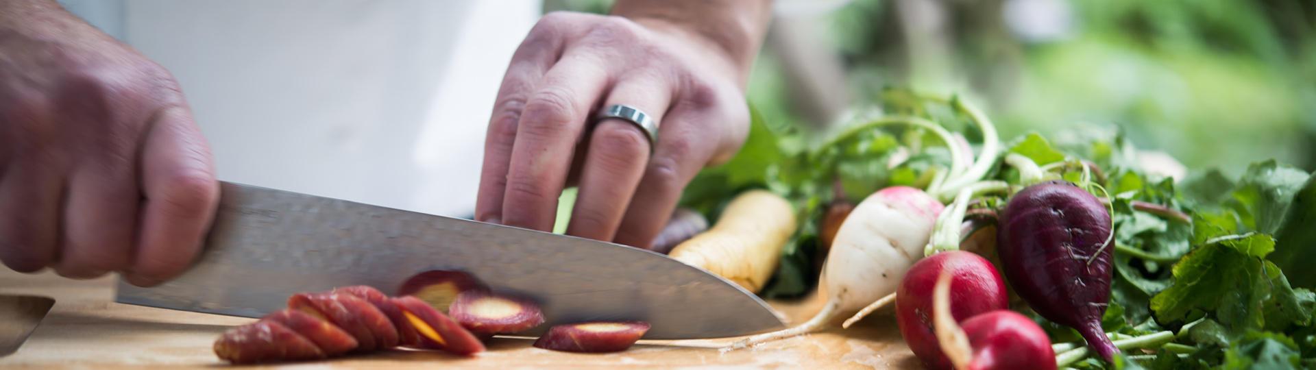 knife chopping a carrot